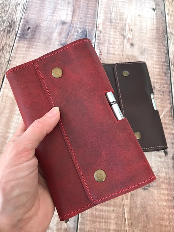 Red Notebook in hand
