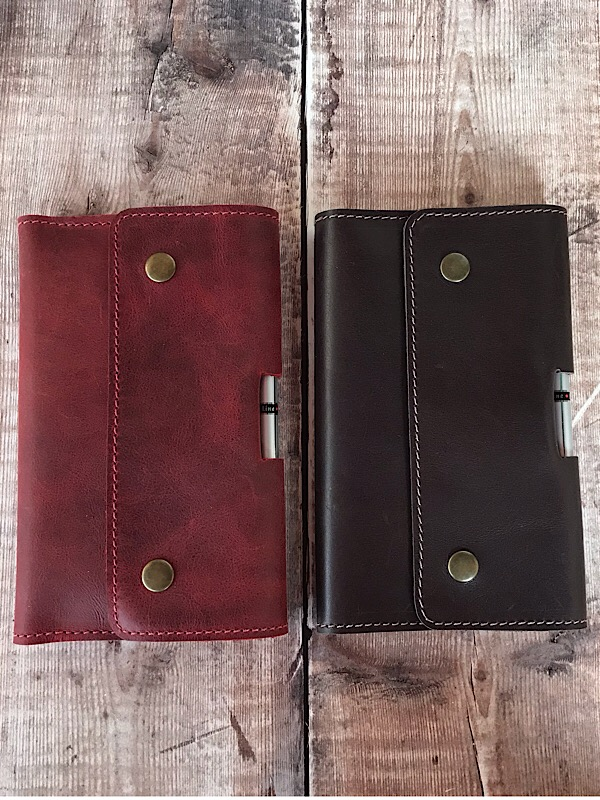 Red and chocolate leather notebook holders